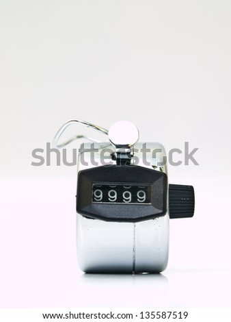 Hand held tally counter isolated on white - stock photo