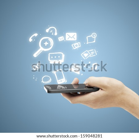 hand hodling phone with social media icon - stock photo