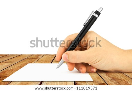 Hand hold a pen writing on wood table over white background