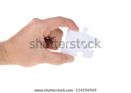 Hand hold a piece of jigsaw puzzle isolated on white - stock photo