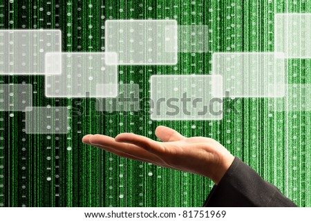 hand hold a touch screen interface with digital matrix background - stock photo