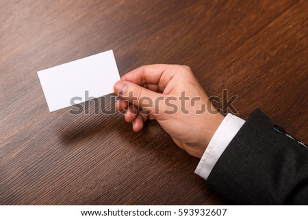 Hand hold blank business card design stock photo safe to use hand hold blank business card design mockup businessman holding visiting card business branding template colourmoves
