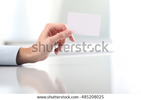 Hand hold blank business card, on desk