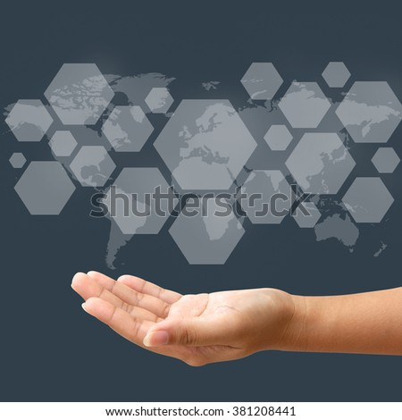 Hand hold blank icon on touch screen interface, wolrd map background - stock photo