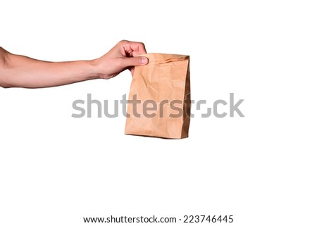 hand hold brown envelope isolated on white background, clipping path  - stock photo