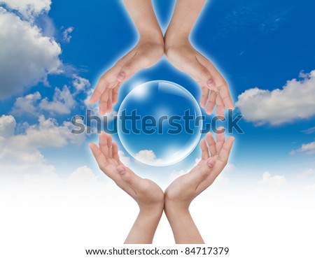 Hand hold Bubbles in the sky - stock photo