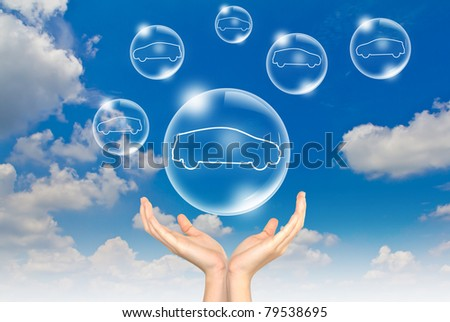 Hand hold Bubbles in the sky with car inside - stock photo