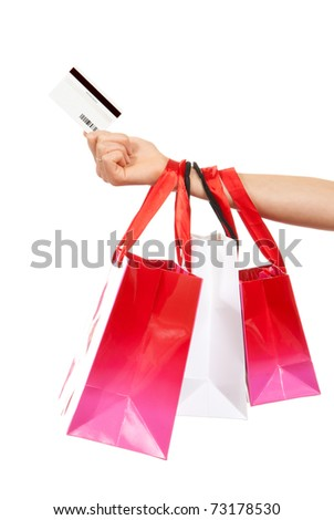 Hand hold credit gift card and shopping bags isolated on a white background - stock photo
