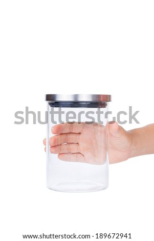 Hand hold Empty glass jar with aluminum lid isolated on white background