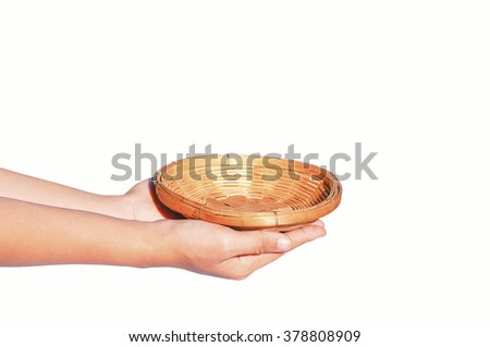 hand hold empty weaved basket made from bamboo isolated on white background - stock photo