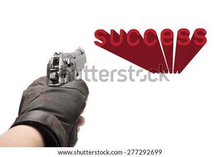 hand hold gun aim the succeess  - stock photo