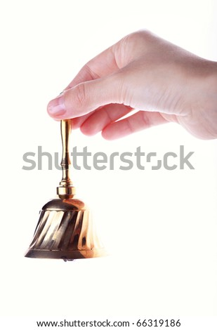 Hand hold handbell isolated on white - stock photo