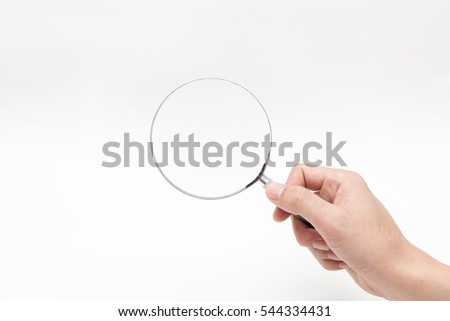 hand hold magnifying glass on white backgrounds