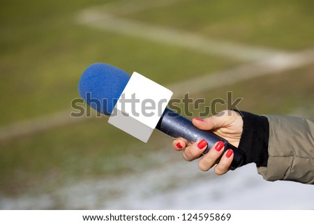 hand hold microphone for interview.
