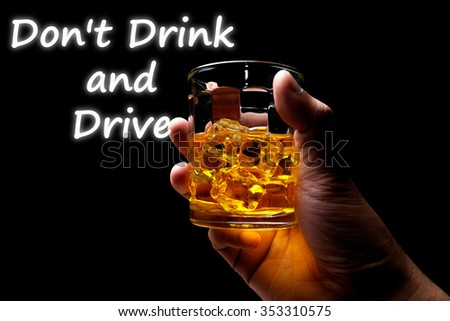 Hand hold mug of scotch whisky and Don't Drink and Drive word. - stock photo