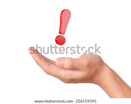hand hold red exclamation mark on white background - stock photo
