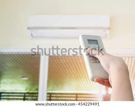 Hand hold remote control directed on the air conditioner
