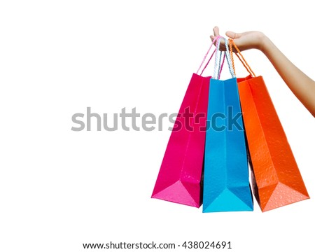 Hand hold shopping bags, white background.