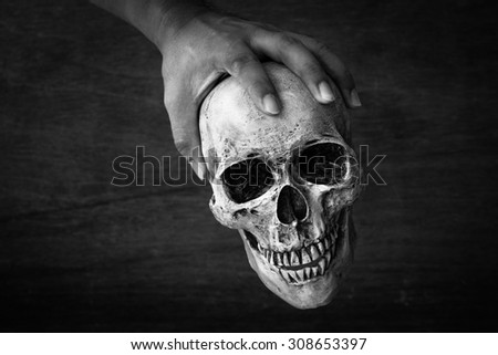 Hand hold skull with black and white color tone