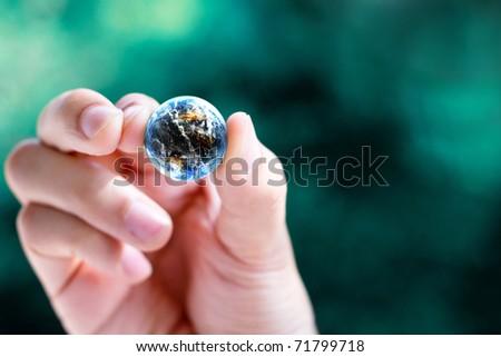 hand hold small world - stock photo