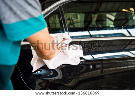 hand hold sponge over the car for washing. - stock photo
