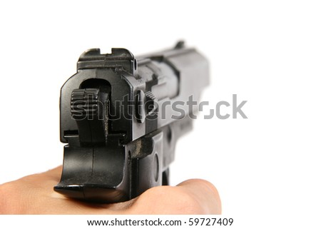 hand hold the gun - stock photo
