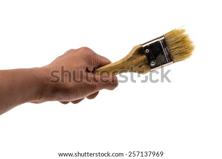 Hand hold used pastry brush, isolated on white background