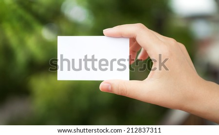 Hand hold white blank business card - stock photo