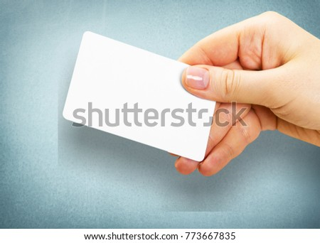 Hand hold white card