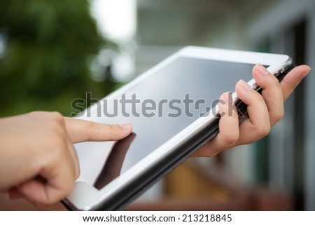 Hand hold white tablet - stock photo
