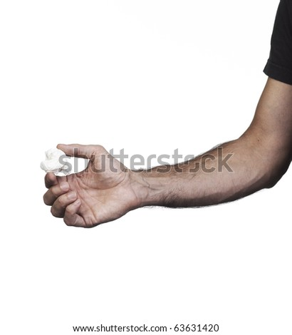 Hand holding a ball white paper on a white set - stock photo