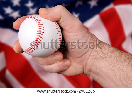 Hand holding a Baseball isolated on blurred USA flag