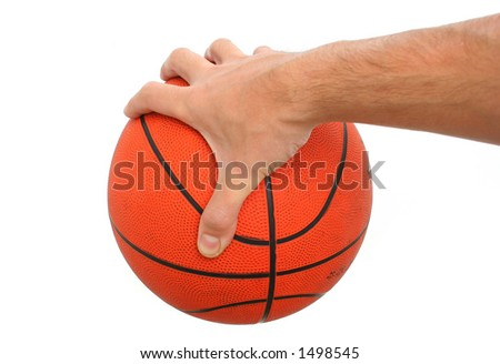 Hand holding a basketball ball isolated. - stock photo