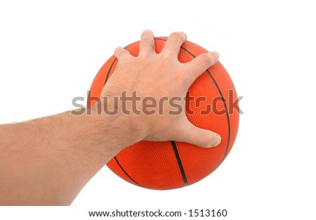 Hand holding a basketball ball isolated. From my sport series. - stock photo
