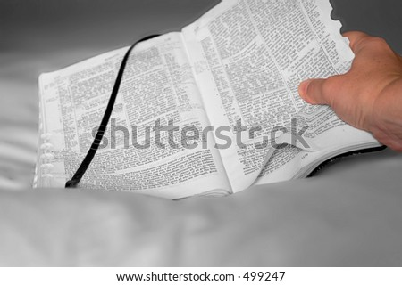 hand holding a Bible - stock photo