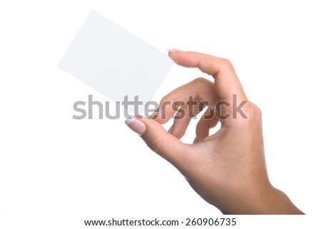 Hand holding a black business card in front of white background.Studio shot isolation on white. - stock photo