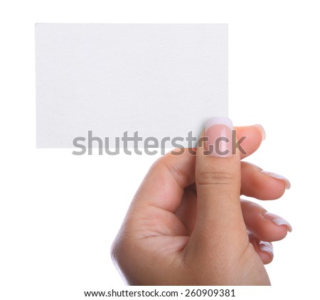 Hand holding a blank business card in front of white background.