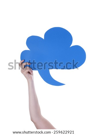 Hand Holding A Blue Empty Speech Balloon Or Speech Bubble. Isolated Photo With Copy Space Or Your Text Here - stock photo