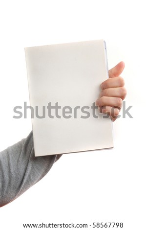 Hand holding a book with blank covers