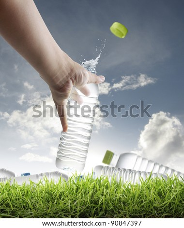 hand holding a bottle of fresh water - stock photo