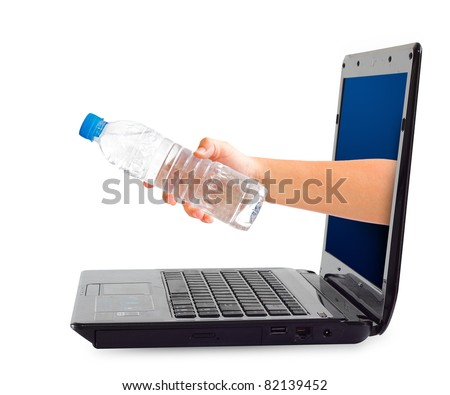 hand holding a bottle of water through a laptop isolated over white background - stock photo