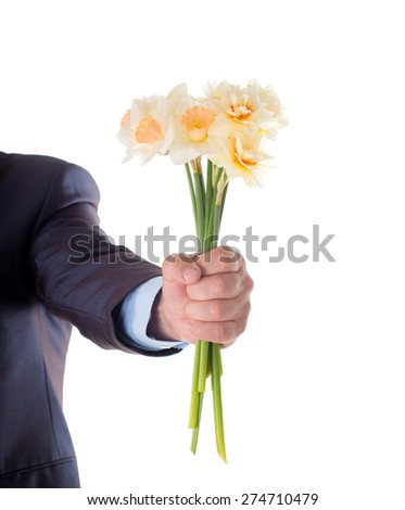 Hand holding a bouquet of daffodils. isolated