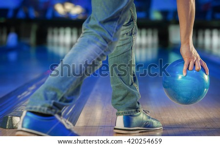 hand holding a bowling ball - stock photo