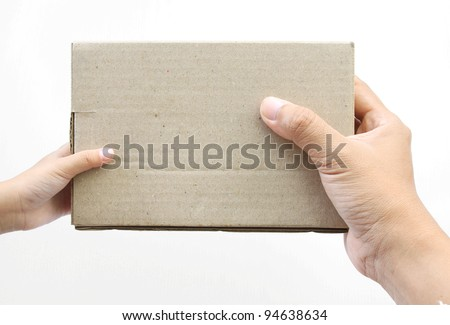 Hand holding a box on white background - stock photo