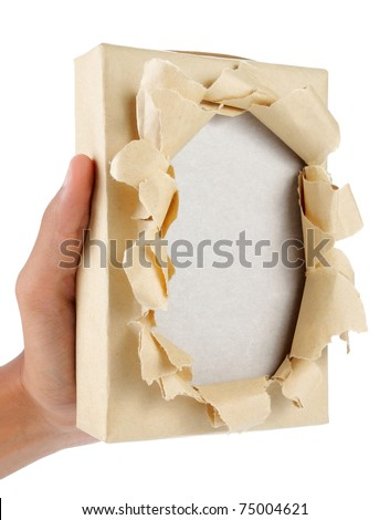 hand holding a brown package torn - stock photo