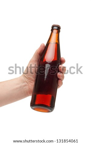 hand holding a brown transparent bottle isolated on white
