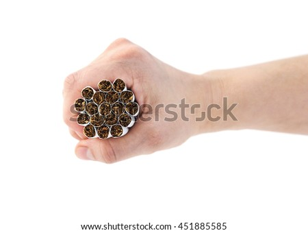 Hand holding a bunch of cigarettes. Focus is on the cigarettes. - stock photo