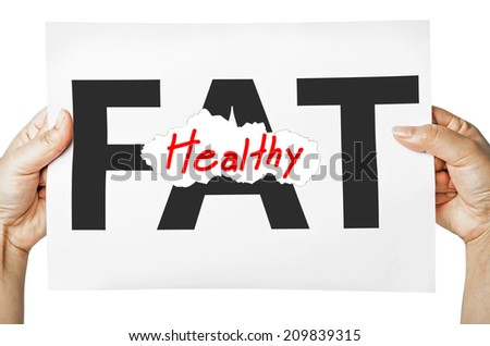 Hand holding a burning paper has FAT text in a middle and see Healthy text behind. Fat burn, Work out concept. - stock photo