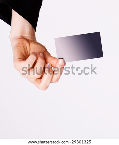 Hand holding a business card isolated on white background