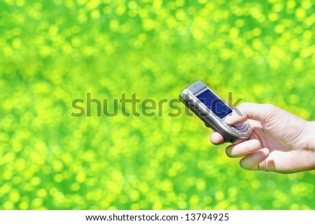Hand holding a cell phone - stock photo